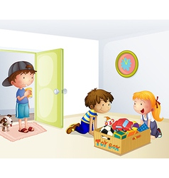 Three kids inside the house with a box of toys vector