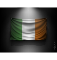 Waving flag ireland on a dark wall vector