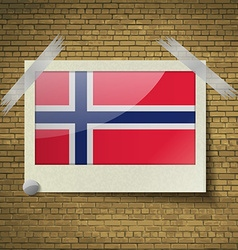 Flags Norwayat frame on a brick background vector image