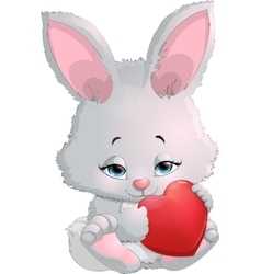 cute bunny holding a heart vector image