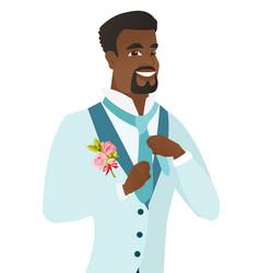 cheerful african-american groom adjusting tie vector image