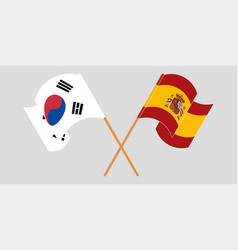 Crossed and waving flags south korea and spain vector