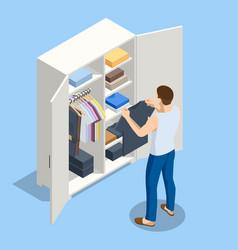 Isometric large wardrobe with things man choosing vector