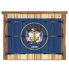 Closed barn door with utah state flag vector