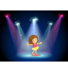 A little girl dancing in the middle of the stage vector image