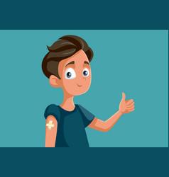 Vaccinated teen boy holding thumbs up cartoon vector