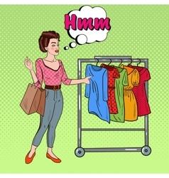 Pop art woman with shopping bags choosing dress vector
