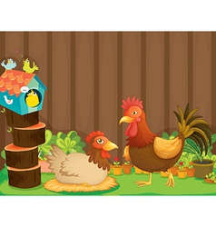 A hen and a rooster beside the bird house vector image