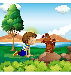 A young boy and his pet near the lake vector image