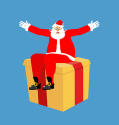 santa claus sitting on gift box isolated vector image