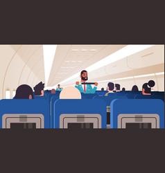 Steward explaining passengers how to use seat belt vector