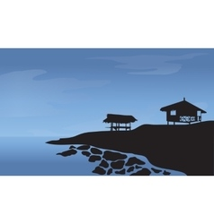 Morning with hut and rocks at the beach vector image