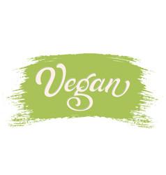 hand drawn lettering vegan on a paint brush stroke vector image