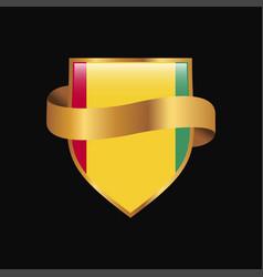 Guinea flag golden badge design vector