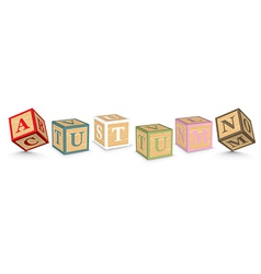 Word AUTUMN written with alphabet blocks vector
