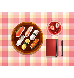 A table with sushi a cocktail drink a ballpen and vector