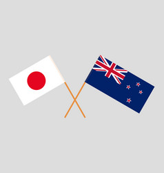 Crossed new zealand and japanese flags vector