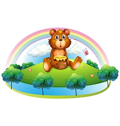 A bear holding a pot of honey at the hill vector image vector image