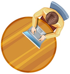 A topview of a man using his laptop above the vector image vector image