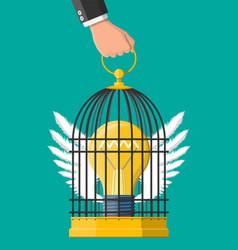 Bird cage in hand with light bulb idea inside vector
