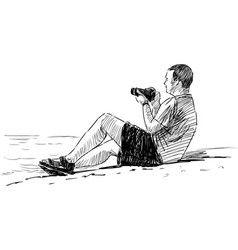 Photographer at seaside vector