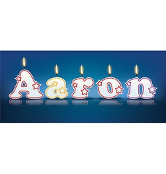 AARON written with burning candles vector image