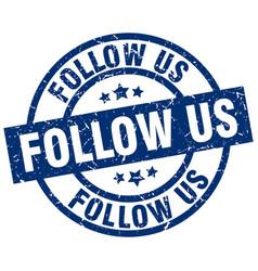 Follow us blue round grunge stamp vector