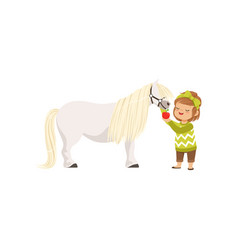 lovely little girl taking care of her pony horse vector image vector image