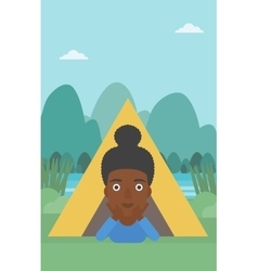 Woman lying in camping tent vector