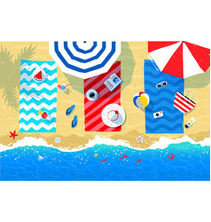 Beach mats and accessories on sand vector