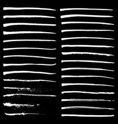 Set of white ink strokes on black background vector