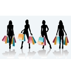 Female black silhouette with shopping bags vector image