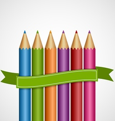 Colorful pencils with green ribbon vector image
