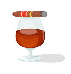 A glass cognac and a cigar vector