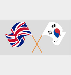 Crossed and waving flags south korea and the uk vector