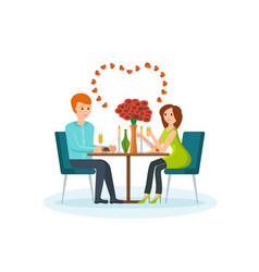 Couple sitting at table in restaurant talking vector