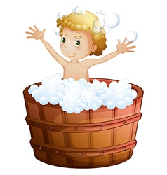 A young boy taking a bath vector image