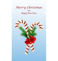 Christmas candy cane decorated with a bow and tree vector