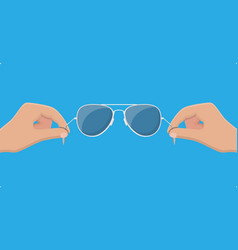Aviator sunglasses in hand protective eyewear vector