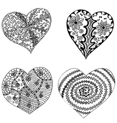 Set of hand drawn hearts in tribal style vector