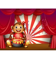 A monkey playing with a musical instrument at the vector image vector image
