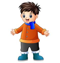 Cartoon happy boy in winter clothes vector