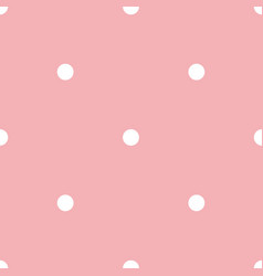 Seamless pattern with polka dots on pink vector