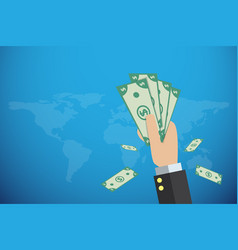 business hand holding banknotes with world map vector image vector image