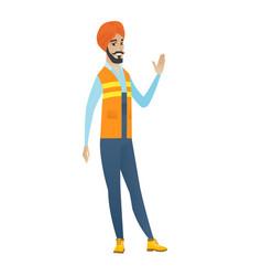 young hindu builder waving his hand vector image vector image