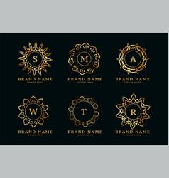 decorative golden mandala style logos vector image