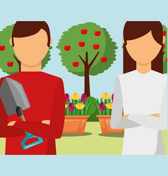 Gardeners man and woman with shovel in the garden vector