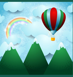 Hot air balloon over the mountain vector