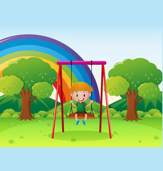 little boy playing on the swing in the park vector image