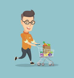 Man running with a trolley full of purchases vector